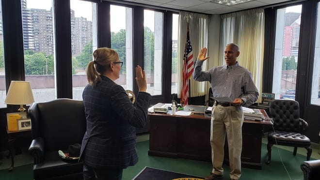 Sgt. Tammy Ryndock is sworn in as a special U.S. marshal.