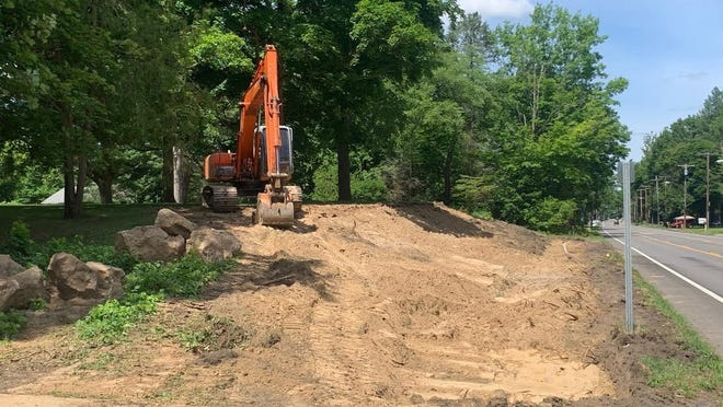 The town of Pittsford's East Avenue sidewalk project required significant excavation in front of St. John Fisher College and power line relocation. An outstanding collaborative effort among the town, college and RG&E ensured a safe and efficient process.