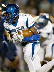 Barron Collier's Jacine Olibrice (7) carries the ball in the first half of action at Naples High School Friday, October 28, 2016 in Naples. Naples led 28-7 over Barron Collier at the half.