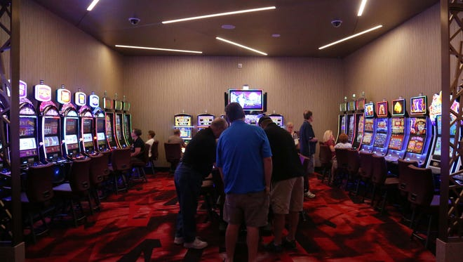 Players gather in the smoke free room at the Wild Rose Casino on July 29, 2015 in Jefferson. The rest of the casino allows smoking but has advanced technology that moves air up from the floor to keep it clean.