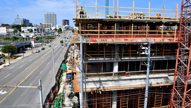 Nashville's professional and business sector, and the construction industry, grew the fastest from 2012 to 2017. Here, workers build 1200 Broadway which will include 65,000 square feet of office space.