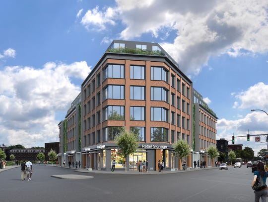 The $30.5 million proposal by Tom Ferrara and Doug Jerum of 158 Monroe Avenue Associates would include 101 apartments, 20 of which would be affordable to those earning the city's median income of $31,000, and three commercial spaces for retail and restaurants.