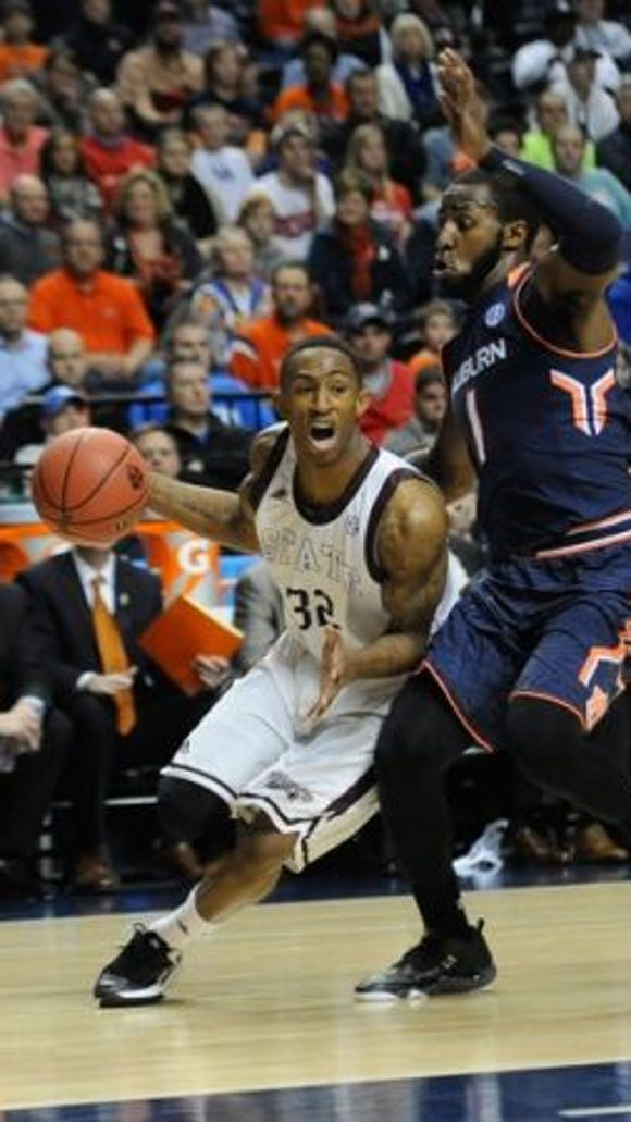 G.W. Carver High graduate Craig Sword, here driving on fellow Montgomery native KT Harrell, scored a team-high 21 points, but was unable to lead Mississippi State past Auburn in the 2015 SEC Tournament opening round game.