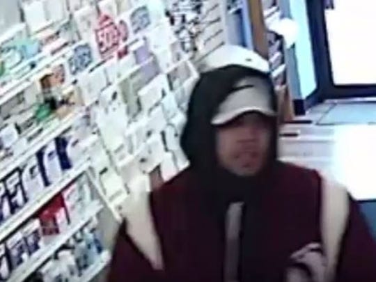 Police are looking for this suspect, who is accused of robbing Miguel's Pharmacy on Dec. 30.