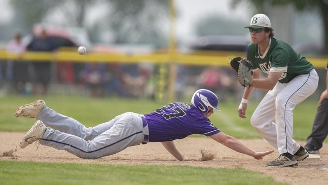 Boylan´s Justin Kerestes waits for the throw as Dixon´s Finn Brandon slides back into first base June 1, 2019, in the Sycamore Sectional final. Kerestes is one of four local players to recently earn a roster spot on the Rockford Rivets for the final two weeks of the Northwoods League season.
