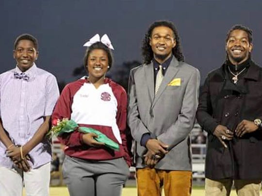 Senior Sade Woodson of Stuarts Draft High School is photographed with brothers Zakar Woodson, Kahlil Woodson and Darius Woodson.
