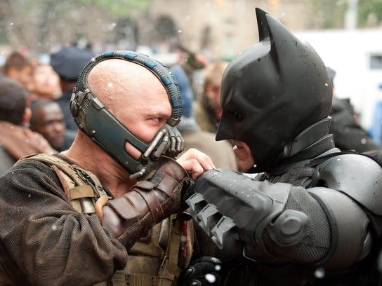 (L-r) Tom Hardy as Bane and Christian Bale as Batman
