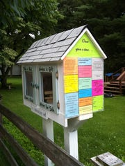 Shannon Raetsch is replacing her old Little Free Library with this larger one. It is decorated with quotes and bright colors and is located at 401 Third Ave. in Haddon Heights.