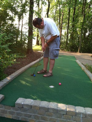 Local residents and visitors enjoy a round at Paradise Park Miniature Golf.