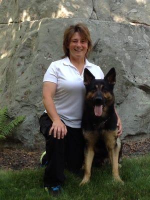 Dog trainer Beth Bradley with her German Shepherd, Fyte.