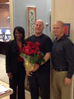 Danny Richter (center) with Pamela Moore, assistant superintendent for Millville Public Schools, and David LaGamba, athletic director and physical education supervisor for Millville Senior High School.