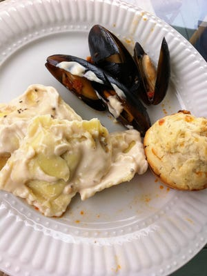 Among the offerings on the Sunday brunch buffet at Parrish Grove Inn in Cocoa Village are cheese biscuits, ravioli and mussels.