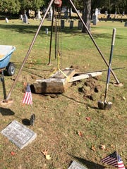A chain fall was used to raise the monument for William Shedrick off the ground to an upright position.