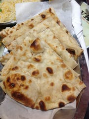 You should order naan to sop up some of the wonderfully rich sauces served at Zayka. Naan is an Indian flatbread.
