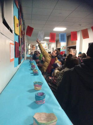 Parents look at the artwork created by kindergarten, first-, and second-grade students at Edmunds Elemetary in Burlington.
