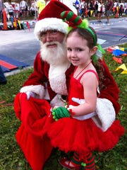 Four-year-old Madison Toenjes of West Melbourne puts in her Christmas wish.