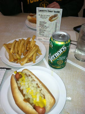 A Coney Island hot dog at Lafayette Coney Island with an order of fries and Vernors, a ginger ale that originated in Detroit.