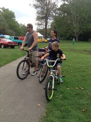 Matt and Julie Burns of Westland and their children Brandon (right), Shawn and Zachary used their bicycles to get to the cruise.