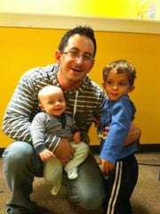 Chris Snyder with his two sons before deployment to Monrovia.