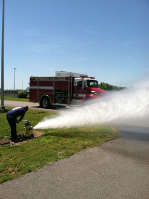 Murfreesboro firefighter tests fire hydrant.