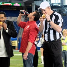 ORG XMIT: CPA111 COMMERCIAL IMAGE - In this photograph released by Papa John's on Monday, Jan. 23, 2012, NFL stars Peyton Manning (right), Jerome Bettis (left) and Papa John's Founder, Chairman and CEO John Schnatter enjoy Papa Johnís pizza and Pepsi MAX during a recent commercial shoot at Lucas Oil Stadium in Indianapolis.  Louisville-based Papa John's (NASDAQ: PZZA) has announced it will offer everyone in America the chance for a free large Papa Johnís pizza and 2-liter Pepsi MAX based on the outcome of the coin toss in Super Bowl XLVI. (AJ Mast/AP Images for Papa John's)