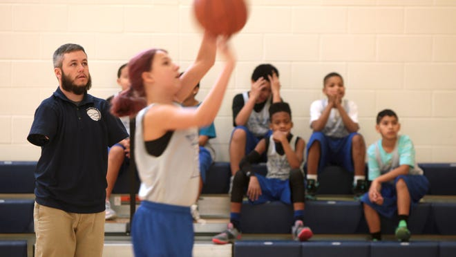 ABE HARRIS Tue., February 24, 2015 Abe Harris guides his Riverview Royals girls basketball team through warm-ups. Harris has played all the sports he coaches. The Enquirer/Cameron Knight