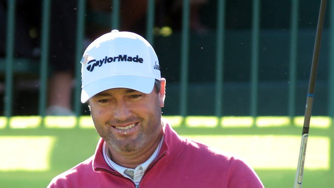 Ryan Palmer, who shot a 61 in round two, gestures to the crowd before starting his third round at the Palmer Private Course at PGA West during the Humana Challenge on Saturday, January 24, 2015 in La Quinta, Calif.