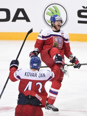 Czech Republic's forward Jakub Voracek celebrates with his teammate forward Jan Kovar after scoring a goal during the group A preliminary round match Latvia vs Czech Republic at the 2015 IIHF Ice Hockey World Championships on May 2, 2015 at the O2 Arena in Prague.