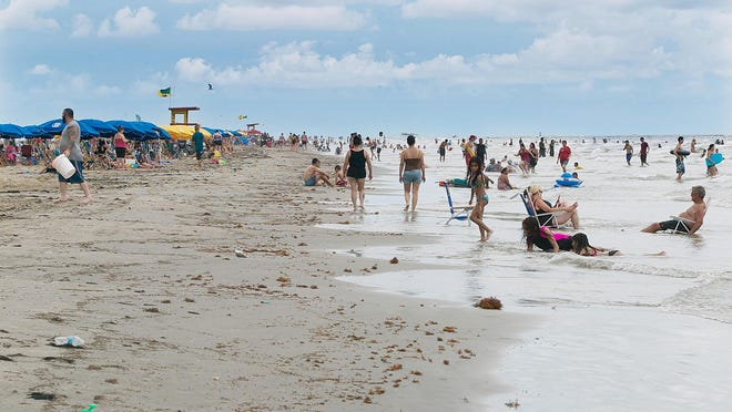 7/20/13 The East beach on Galveston Island is popular because of the easy access and beach parking. It is a popular spot for evening beach parties. Nell Carroll/American-Statesman