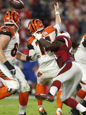 Cardinals' Markus Golden hits Bengals' Andy Dalton in the second half on Nov. 22, 2015 in Glendale, Ariz.