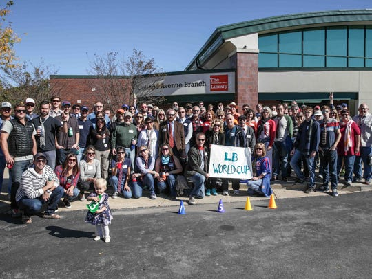 Event participants and staff pose for a photo during