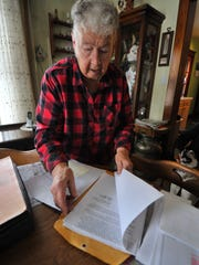 Virginia Zastrow pages through documents in her Wausau home.