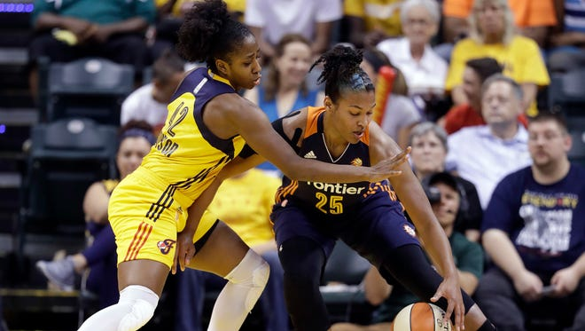 Connecticut Sun's Alyssa Thomas (25) is defended by Indiana Fever's Shenise Johnson (42) during the first half of a WNBA basketball game Wednesday, July 13, 2016, in Indianapolis. (AP Photo/Darron Cummings)