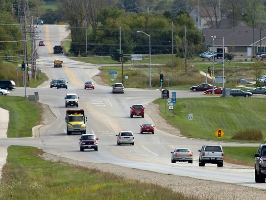 Traffic moves along the two-lane Meadowbrook and Merrill