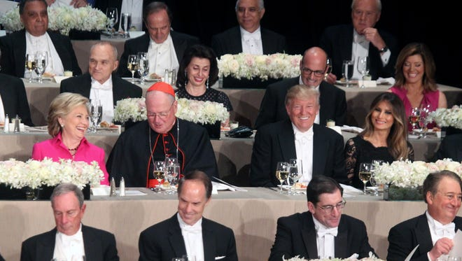 Hillary Clinton, left, Cardinal Timothy  Dolan, archbishop of New York, Donald Trump and Melania Trump attend the Alfred E. Smith Memorial Foundation Dinner at the Waldorf Astoria in New York City Oct. 20, 2016.