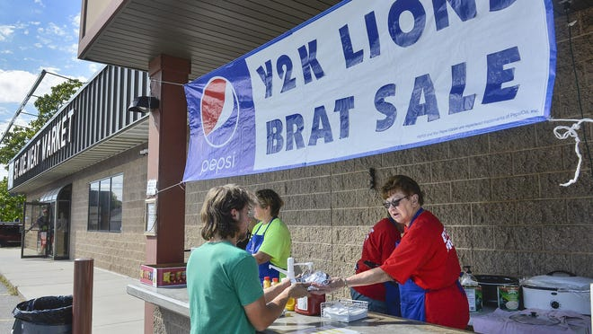 Virginia Meier, right, and other members of the Y2K Lions Club sell brats in front of the St. Joseph Meat Market Saturday, Sept. 3, in St. Joseph. Each member there remembered where she was the day Jacob Wetterling was abducted.