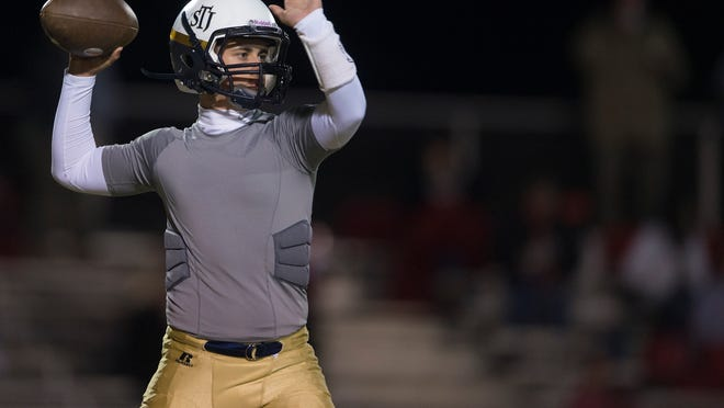 St. James quarterback Connor Collier throws a pass before the game between St. James and Munford on Friday, Nov. 7, 2014, at St. James High School in Montgomery, Ala.