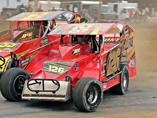 Jeff Strunk (inside) and Anthony Perrego (126) battle for the Modified lead at Georgetown Speedway.