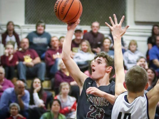 Cannon County's Austin Duggin attemps a shot Tuesday at Central Magnet.