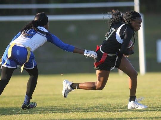 Florida High's Jada Rhodes runs after a catch.