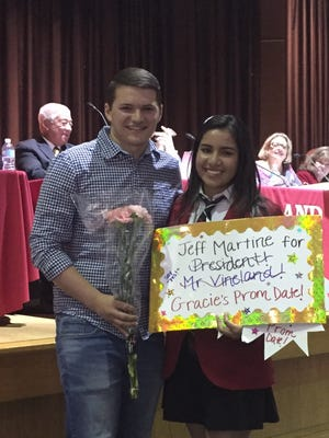 Vineland High School senior class president Gracie Galan surprised VHS class of 2016 president Jeff Martine with a promposal at the Vineland school board meeting on Wednesday.