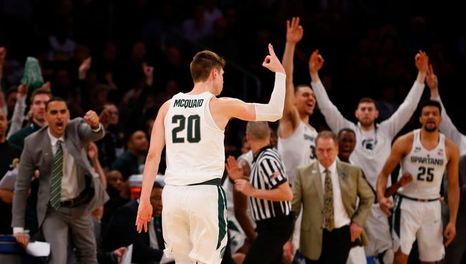 Michigan State Spartans guard Matt McQuaid (20) reacts after making a three point shot against Wisconsin Badgers during second half of 2018  Big Ten Tournament quarterfinals at Madison Square Garden.