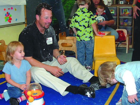 Boston Red Sox pitcher Tim Wakefield sits and plays