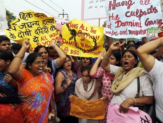Activists demonstrate before a court handed down death sentences to four men convicted for a fatal 2012 gang rape in New Delhi, India.. A young woman was repeatedly raped and beaten in a moving bus on Dec, 16, 2012, and died two weeks later due to multiple organ failure brought on by internal injuries.
