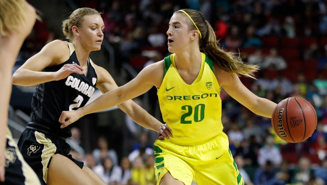 Oregon guard Sabrina Ionescu (20) drives against Colorado guard Alexis Robinson, left, during the first half of an NCAA college basketball game in the quarterfinals of the Pac-12 Conference women's tournament, Friday, March 2, 2018, in Seattle. Oregon won 84-47. (AP Photo/Ted S. Warren)
