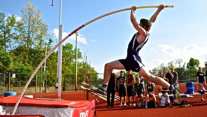 Elder High School senior Robby Oswald takes off on a pole vault attempt at the Greater Catholic League South championships May 11 at La Salle High School.