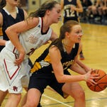 Huskies' Becca Richards brings the ball up court on Monday during girls district basketball action at Macomb Dakota.