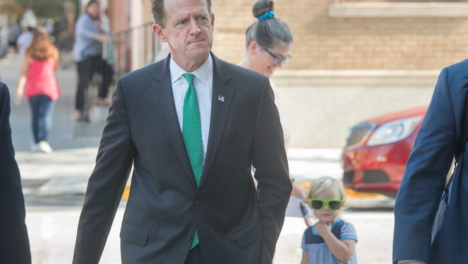 Sen. Pat Toomey walks down West Market Street in York before a Rotary Club of York lunch.