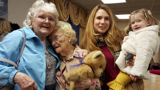 After a 50-year search, Betty Morrell, left, and her birth mother, Lena Pierce, are reunited  Jan.15. When they finally met, Morrell was 82 and Pierce was 96. Morrell's granddaughter, Kimberly Miccio, holding her daughter, accompanied Morrell from Spring Hill, Fla.