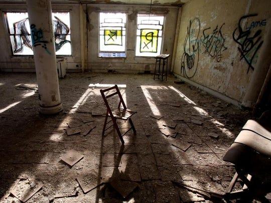 Sunlight comes through the graffiti windows of the